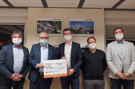 Gemeinsame Spendenscheckübergabe der JF Group und AHT Menzel Services über 14.000 €